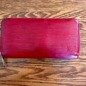 Well used Louis Vuitton Epi zippy wallet
